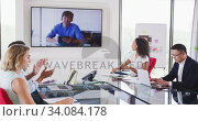 Купить «Professional businesspeople in video conference clapping together in meeting room in modern office i», видеоролик № 34084178, снято 18 января 2020 г. (c) Wavebreak Media / Фотобанк Лори