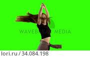 Купить «Young woman dancing against green screen background», видеоролик № 34084198, снято 29 августа 2017 г. (c) Wavebreak Media / Фотобанк Лори