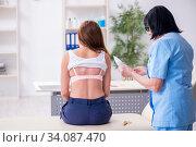 Купить «Young woman visiting old female doctor dermatologist», фото № 34087470, снято 16 октября 2019 г. (c) Elnur / Фотобанк Лори