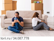 Купить «Young pair and many boxes in divorce settlement concept», фото № 34087778, снято 3 сентября 2019 г. (c) Elnur / Фотобанк Лори