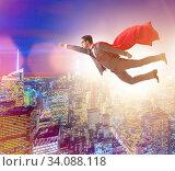 Superhero businessman flying over the city. Стоковое фото, фотограф Elnur / Фотобанк Лори
