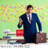Купить «Businessman with many conflicting priorities», фото № 34088322, снято 23 мая 2018 г. (c) Elnur / Фотобанк Лори