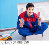 Купить «Young man doing home renovation», фото № 34088350, снято 3 мая 2018 г. (c) Elnur / Фотобанк Лори