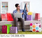 Купить «Young man buying clothing online and running blog», фото № 34088478, снято 22 декабря 2017 г. (c) Elnur / Фотобанк Лори