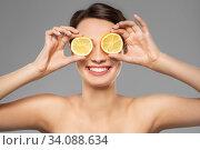 Купить «beautiful woman making eye mask of lemon slices», фото № 34088634, снято 30 ноября 2019 г. (c) Syda Productions / Фотобанк Лори