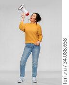 Купить «young woman speaking to megaphone», фото № 34088658, снято 20 марта 2020 г. (c) Syda Productions / Фотобанк Лори