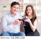 Купить «Young pair drinking wine in romantic concept», фото № 34089238, снято 1 апреля 2017 г. (c) Elnur / Фотобанк Лори