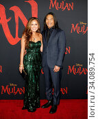 Jason Scott Lee and Diana Chan at the World premiere of Disney's 'Mulan' held at the Dolby Theatre in Hollywood, USA on March 9, 2020. Стоковое фото, фотограф Zoonar.com/Lumeimages / age Fotostock / Фотобанк Лори
