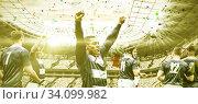 Купить «Digital composite image of team of rugby players celebrating a win in sports stadium», фото № 34099982, снято 4 августа 2020 г. (c) Wavebreak Media / Фотобанк Лори