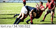 Купить «Digital composite image of team of rugby players tackling each other to win the ball in stadium», фото № 34100022, снято 4 августа 2020 г. (c) Wavebreak Media / Фотобанк Лори