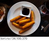 Delicious cheese sticks with mozzarella cheese and sauce. Стоковое фото, фотограф Яков Филимонов / Фотобанк Лори