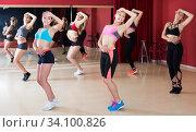 Купить «Positive females exercising dance moves», фото № 34100826, снято 31 мая 2017 г. (c) Яков Филимонов / Фотобанк Лори
