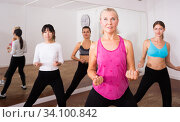 Купить «Ordinary active females exercising dance moves», фото № 34100842, снято 21 сентября 2019 г. (c) Яков Филимонов / Фотобанк Лори