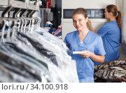 Купить «Girl working at dry cleaner», фото № 34100918, снято 9 мая 2018 г. (c) Яков Филимонов / Фотобанк Лори