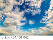 Beautiful white cirrus clouds on a background of blue sky lit by the sun. Стоковое фото, фотограф Акиньшин Владимир / Фотобанк Лори