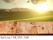 Rough wooden table on natutal rural sunset landscape a for display and montage your products. Стоковое фото, фотограф Ярослав Данильченко / Фотобанк Лори