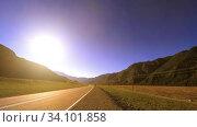 Купить «Mountain road timelapse at the summer or autumn sunset sunrise time. Wild nature and rural field.», видеоролик № 34101858, снято 8 июня 2018 г. (c) Александр Маркин / Фотобанк Лори