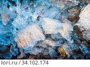 Купить «Pieces of melting ice under the bright Spring sun on the river bank. Selective focus macro shot with shallow DOF.», фото № 34102174, снято 4 июля 2020 г. (c) age Fotostock / Фотобанк Лори