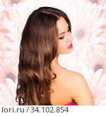 Купить «Young attractive woman appears from bouquet flowers over pink background.», фото № 34102854, снято 3 июля 2020 г. (c) age Fotostock / Фотобанк Лори