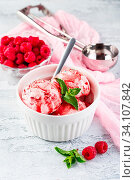Купить «Raspberry ice cream balls with syrup, berries and mint leaves in white bowl», фото № 34107842, снято 6 июля 2020 г. (c) easy Fotostock / Фотобанк Лори