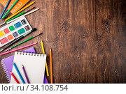 Купить «School supplies on a wooden table, space for your text, top view», фото № 34108754, снято 3 июля 2020 г. (c) easy Fotostock / Фотобанк Лори