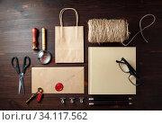 Купить «Corporate identity template. Blank kraft paper stationery mock up on wood table background. Flat lay.», фото № 34117562, снято 10 июля 2020 г. (c) easy Fotostock / Фотобанк Лори