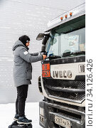Купить «Orenburg, Russia - December, 17, 2019: A videographer fixes shooting equipment in front of the windshield of a truck cab», фото № 34126426, снято 17 декабря 2019 г. (c) Вадим Орлов / Фотобанк Лори