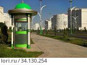 Купить «Ashgabat, Turkmenistan - October 15, 2014: Modern architecture of Ashgabat. Telephone Booth on new wide boulevard. Ashkhabad. Turkmenistan in October 15, 2014.», фото № 34130254, снято 15 октября 2014 г. (c) easy Fotostock / Фотобанк Лори