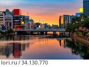 Купить «Fukuoka old town along naka river at Nakasukawabata sunset twilight. This area is favorite for tourist for Fukuoka Yatai, street Food stall, for hangout at night.», фото № 34130770, снято 5 июля 2020 г. (c) easy Fotostock / Фотобанк Лори