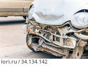 Купить «Broken passenger car after an accident. Close-up.», фото № 34134142, снято 30 апреля 2020 г. (c) Акиньшин Владимир / Фотобанк Лори