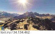 Купить «360 VR Gokyo Ri mountain top. Tibetan prayer Buddhist flag. Wild Himalayas high altitude nature and mount valley. Rocky slopes covered with ice. Panorama movement», видеоролик № 34134462, снято 28 мая 2020 г. (c) Александр Маркин / Фотобанк Лори