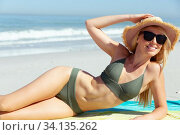 Купить «Woman sunbathing while laying on the beach», фото № 34135262, снято 25 февраля 2020 г. (c) Wavebreak Media / Фотобанк Лори