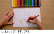 Купить «Crop unrecognizable artist drawing with pencil on paper at work», видеоролик № 34141078, снято 25 июня 2020 г. (c) Ekaterina Demidova / Фотобанк Лори