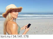 Купить «Woman using smartphone on the beach», фото № 34141178, снято 25 февраля 2020 г. (c) Wavebreak Media / Фотобанк Лори