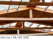 Купить «Double roof rafters. Construction of second floor inside», фото № 34141538, снято 23 июня 2020 г. (c) Евгений Ткачёв / Фотобанк Лори