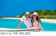 Купить «Young happy couple have fun on summer tropical vacation», фото № 34143262, снято 3 июля 2020 г. (c) easy Fotostock / Фотобанк Лори