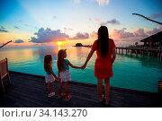 Купить «Young mother and two her kids at exotic resort», фото № 34143270, снято 3 июля 2020 г. (c) easy Fotostock / Фотобанк Лори