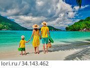 Купить «Family on beach, young couple in yellow with three year old boy. Summer vacation at Seychelles. Port Launay, Mahe.», фото № 34143462, снято 3 июля 2020 г. (c) easy Fotostock / Фотобанк Лори