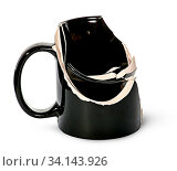 Купить «Broken black ceramic cup fragments are inside isolated on white background», фото № 34143926, снято 9 июля 2020 г. (c) easy Fotostock / Фотобанк Лори