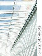 Купить «Roof Construction. Joist, rafter. Abstract contemporary architecture or modern interior photograph. Geometric shapes and patterns. Shadow on the white wall.», фото № 34144642, снято 3 июля 2020 г. (c) easy Fotostock / Фотобанк Лори