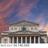 Bolshoi Theatre (Large, Great or Grand Theatre, also spelled Bolshoy) on a beautiful sky with cloud before sunset background, Moscow, Russia (2018 год). Стоковое фото, фотограф Владимир Журавлев / Фотобанк Лори