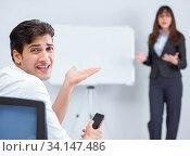 Купить «Business presentation in the office with man and woman», фото № 34147486, снято 7 августа 2017 г. (c) Elnur / Фотобанк Лори