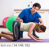 Купить «Fitness instructor helping sportsman during exercise», фото № 34148182, снято 10 июля 2018 г. (c) Elnur / Фотобанк Лори