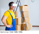 Купить «Painter contractor working with virtual reality goggles», фото № 34148186, снято 23 мая 2017 г. (c) Elnur / Фотобанк Лори