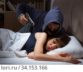 Купить «Burglar breaking into house at night to bedroom with sleeping wo», фото № 34153166, снято 9 августа 2017 г. (c) Elnur / Фотобанк Лори
