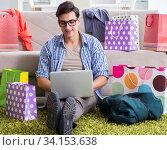Купить «Young man buying clothing online and running blog», фото № 34153638, снято 22 декабря 2017 г. (c) Elnur / Фотобанк Лори