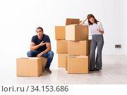 Купить «Young pair and many boxes in divorce settlement concept», фото № 34153686, снято 3 сентября 2019 г. (c) Elnur / Фотобанк Лори