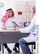Купить «Young male arab visiting experienced male doctor», фото № 34154278, снято 16 августа 2019 г. (c) Elnur / Фотобанк Лори