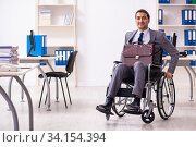 Disabled employee in the office. Стоковое фото, фотограф Elnur / Фотобанк Лори