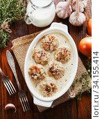 Купить «Meatballs with rice in a creamy sauce», фото № 34155414, снято 17 января 2020 г. (c) Надежда Мишкова / Фотобанк Лори